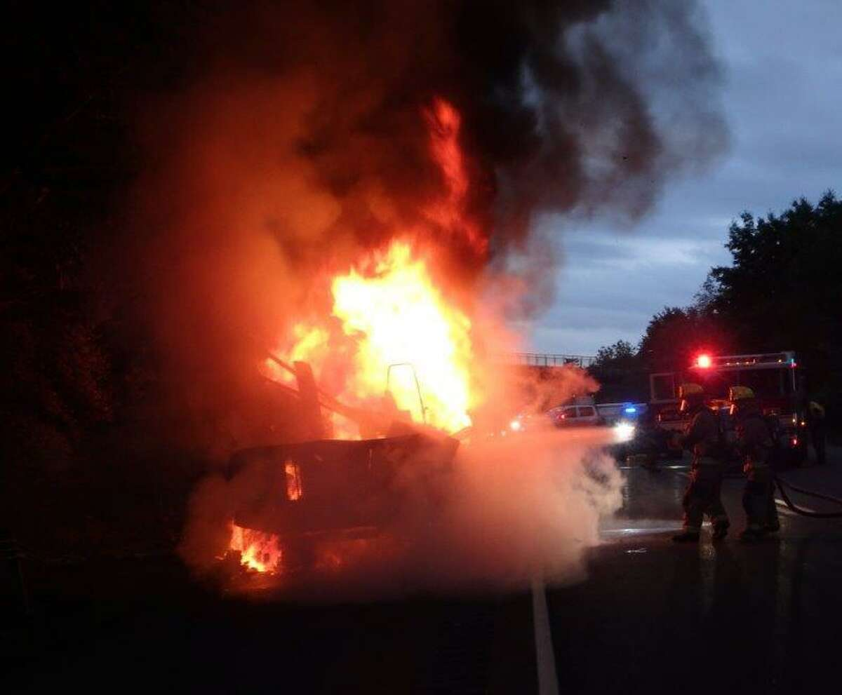 Shelton firefighters battled a vehicle fire on Route 8 early in the morning on July 17.
