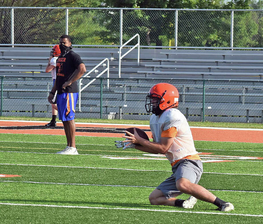Edwardsville tight end Pierce Boyer hauls in a pass from quarterback Ryan Hampton during a drill Tuesday inside the District 7 Sports Complex. Photo: Matt Kamp|The Intelligencer