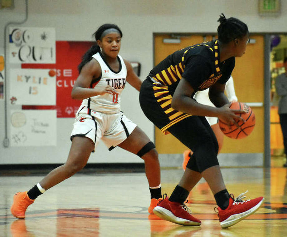 Edwardsville point guard Quierra Love plays defense during a home game inside Lucco-Jackson Gymnasium during her senior season.