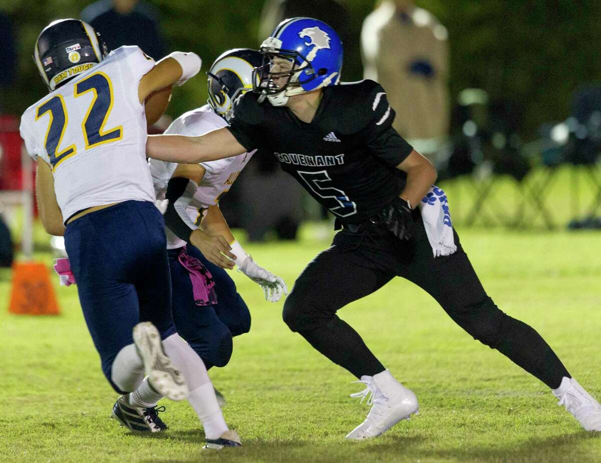 Covenant Christian defensive end Cole Brinkley (5) tackles Covenant-Allen running back Brent Trucker (22) during the first quarter of a TAPPS District 3-2A high school football game, Friday, Oct. 25, 2019, in Conroe.