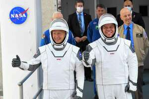 NASA commercial crew astronauts Doug Hurley, left, and Bob Behnken leave for their flight aboard the SpaceX Falcon 9 rocket and Crew Dragon spacecraft on May 27, 2020. The flight was scrubbed that day and ultimately launched on May 30, 2020.