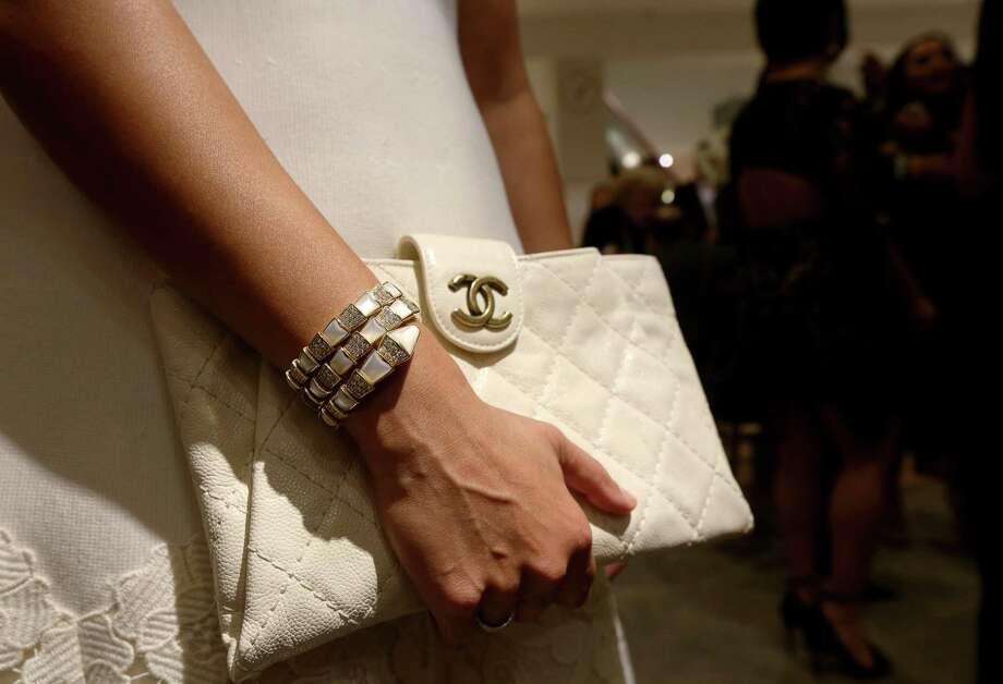 Will a handbag remain a necessary part of a woman's wardrobe? Photo: Jon Shapley, Staff / Houston Chronicle / © 2017  Houston Chronicle