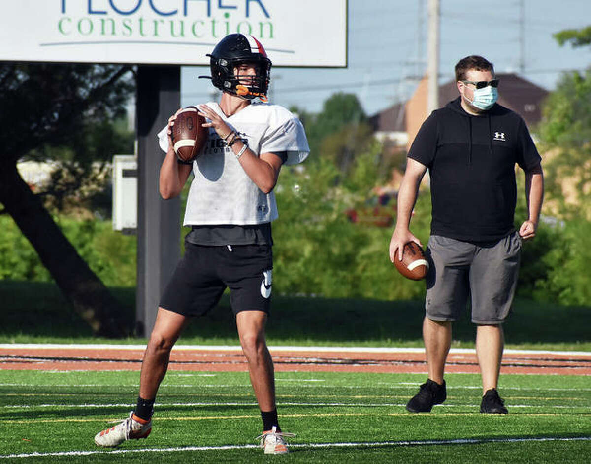 Edwardsville quarterback Ryan Hampton drops back for a pass during practice on Tuesday inside the District 7 Sports Complex.