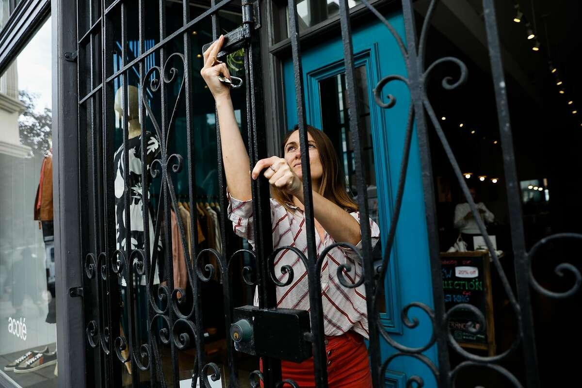Store manager Kathryn Sandretto closes down store Acote in Hayes Valley after Mayor London Breed announced that six Bay Area counties would lockdown non-essential services due to the coronavirus on Monday, March 16, 2020 in San Francisco, California