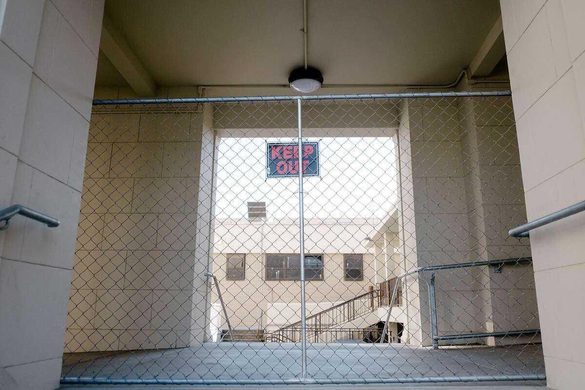 A section of Alameda High School is fenced off.