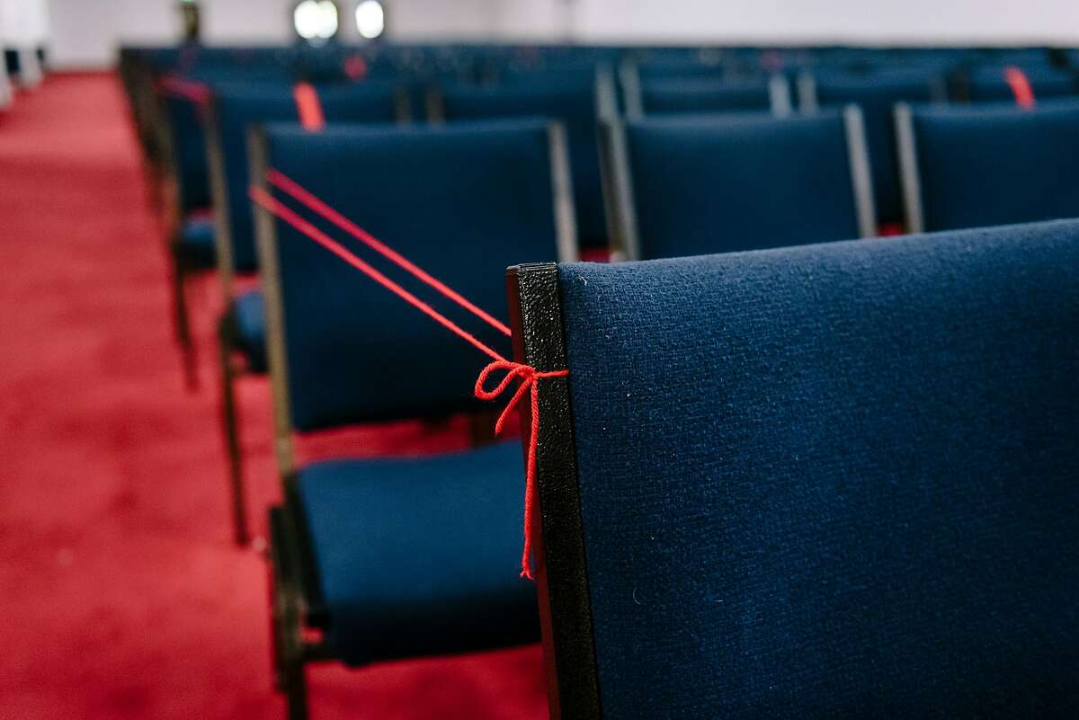 Seating is marked off with string and tape for social distancing at Acts Full Gospel Church of God in Christ in Oakland, Calif, on Thursday, July 16th, 2019.