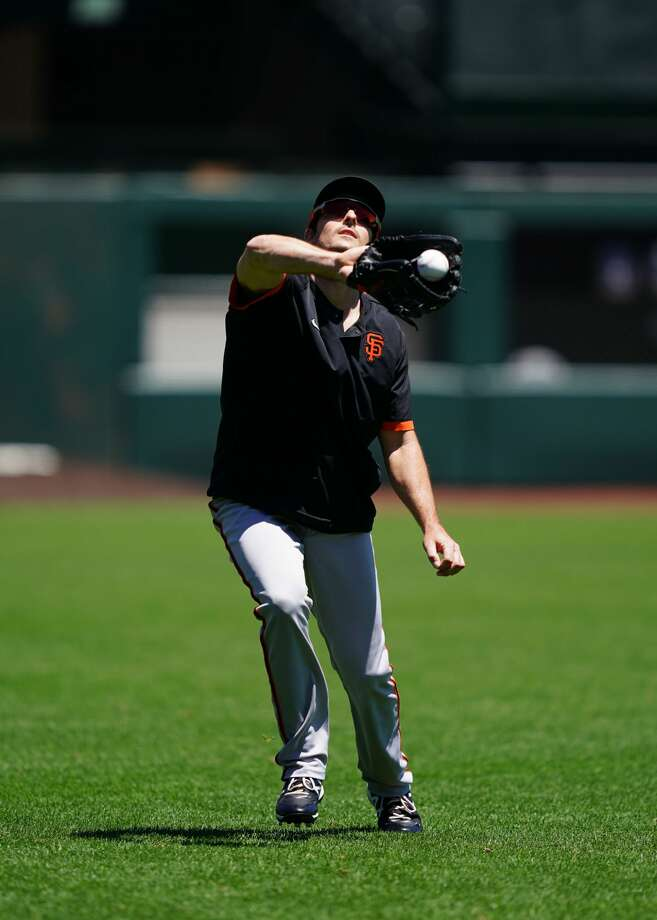 Mike Yastrzemski catches a flyball during summer training on July 5, 2020. Photo: Suzanna Mitchell / SF Giants / © 2020 S.F. Giants/Mitchell