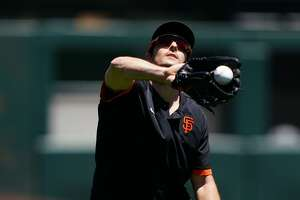 Mike Yastrzemski catches a flyball during summer training on July 5, 2020.