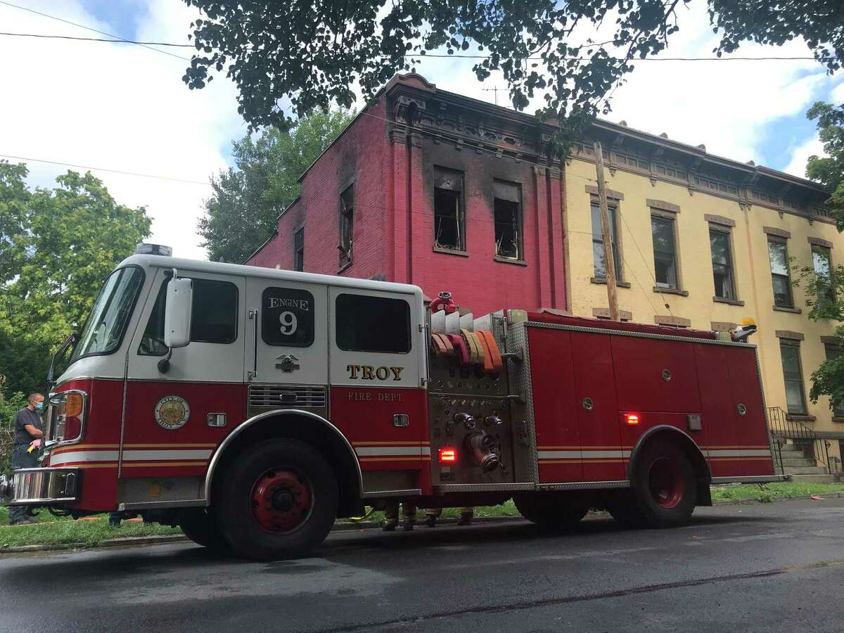 A Troy fire truck outside 177 Third St. after the fire that sent four residents and a firefighter to local hospitals was extinguished Friday July 17, 2020 in Troy, N.Y.