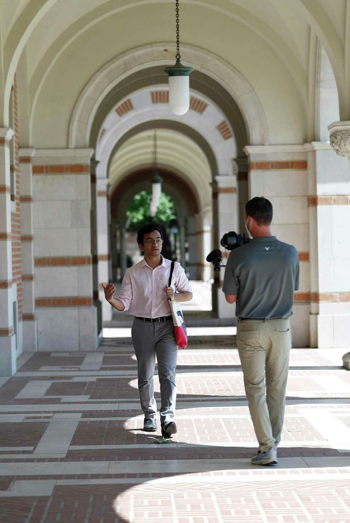 Brandon Martin, the manager of videography at Rice University, shoots video footage of Shree Kale, who graduated from the School of Architecture, on the Rice campus in Houston, Friday, May 1, 2020.