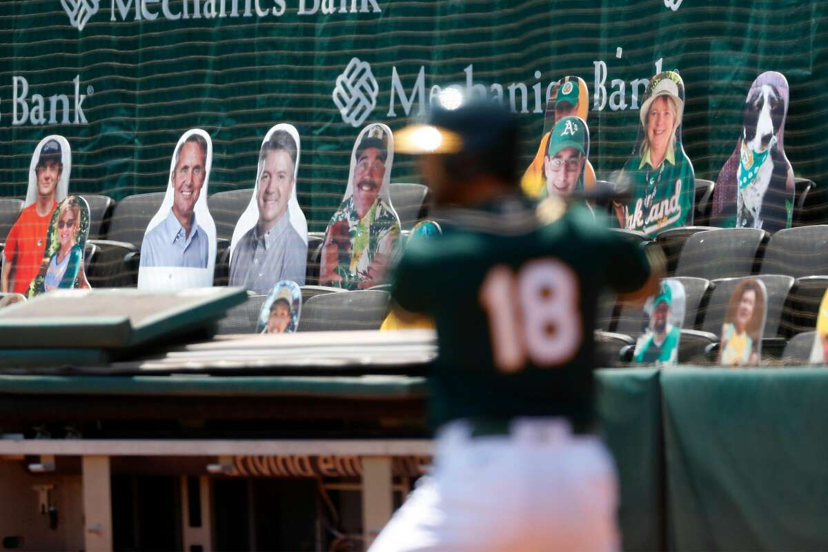 Oakland Athletics have placed cut out photos of season ticket holders in the seats around the lower bowl of Oakland Coliseum in Oakland, Calif., on Thursday, July 16, 2020.