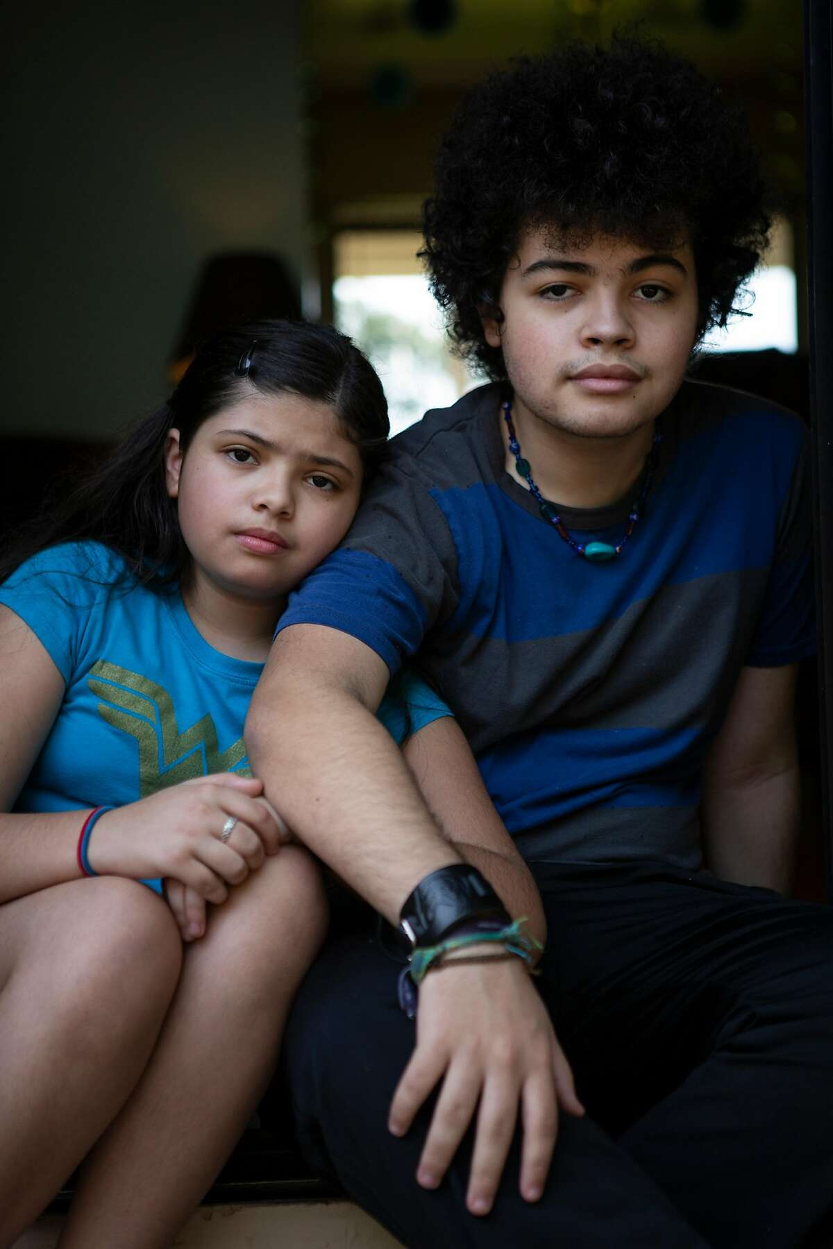 Joaquin and Amaya Williams sit in the doorway of their house. The Williams family have been sheltering-in-place at their home in Petaluma, California since March.