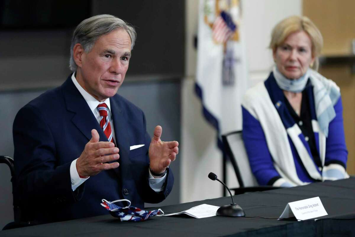 Texas Gov. Greg Abbott responds to question as Dr. Deborah Birx, White House coronavirus response coordinator, looks on during a news conference after Vice President Mike Pence met with Abbott and members of his healthcare team regarding COVID-19 at the University of Texas Southwestern Medical Center West Campus in Dallas, Sunday, June 28, 2020. (AP Photo/Tony Gutierrez)