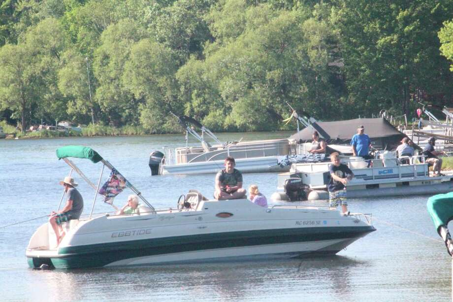 Anglers test their luck recently at Chippewa Lake. (Pioneer photo/John Raffel)