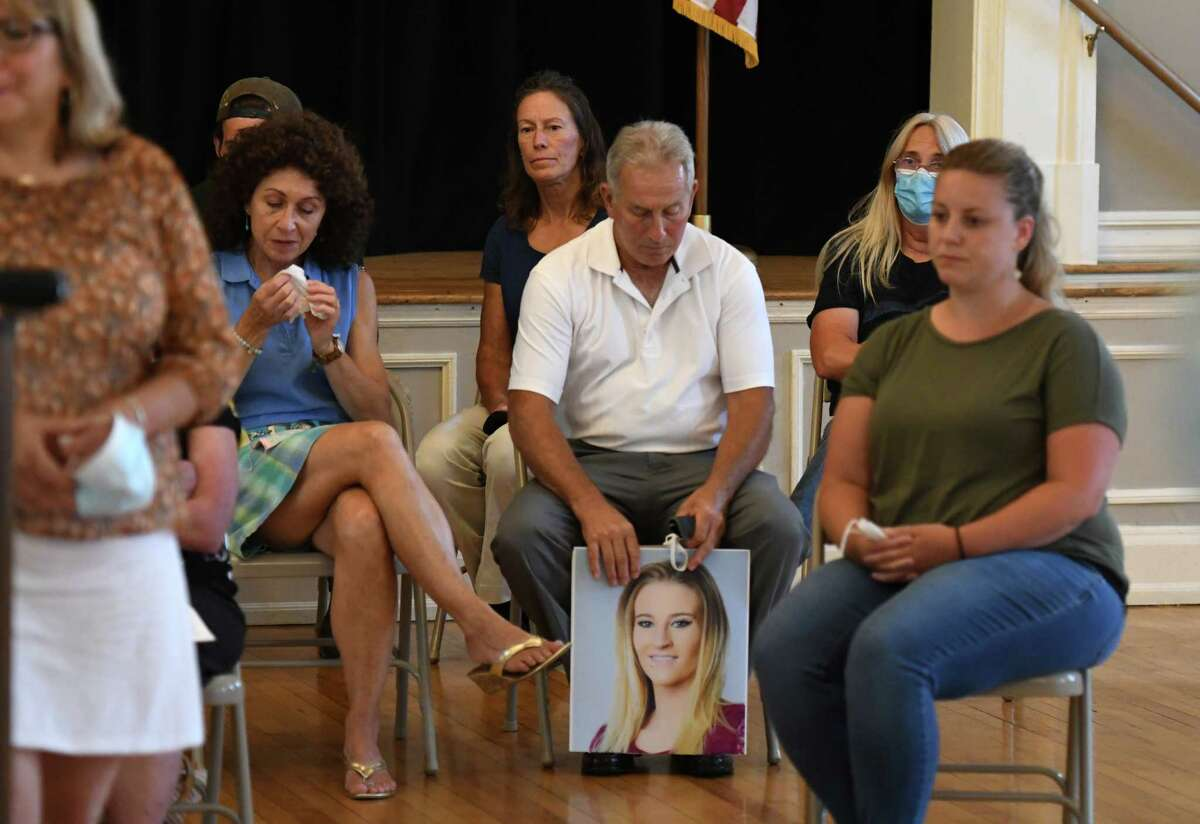 Sam Bursese, center, who lost his daughter, Savannah Bursese, in the Oct. 6, 2018 Schoharie limousine crash that killed 20 people, holds a photo of Savannah during a news conference where family members voiced their disappointment and frustration in the plea-bargain process in the prosecution of Nauman Hussain, the who operated the company that owned the limo. (Will Waldron/Times Union)
