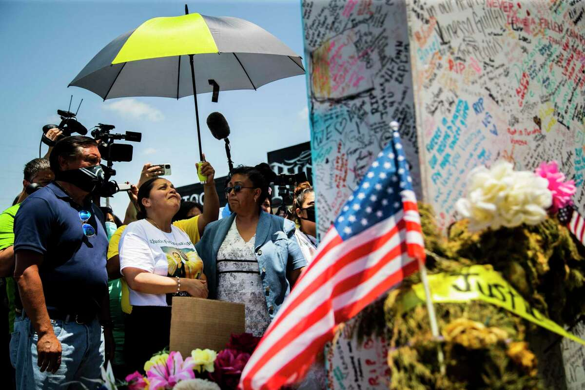 Gloria Guillén, the mother of Army Spc. Vanessa Guillén, looks up and prays in front of a mural in remembrance of her daughter on Friday, July 17, 2020, in Fort Hood.