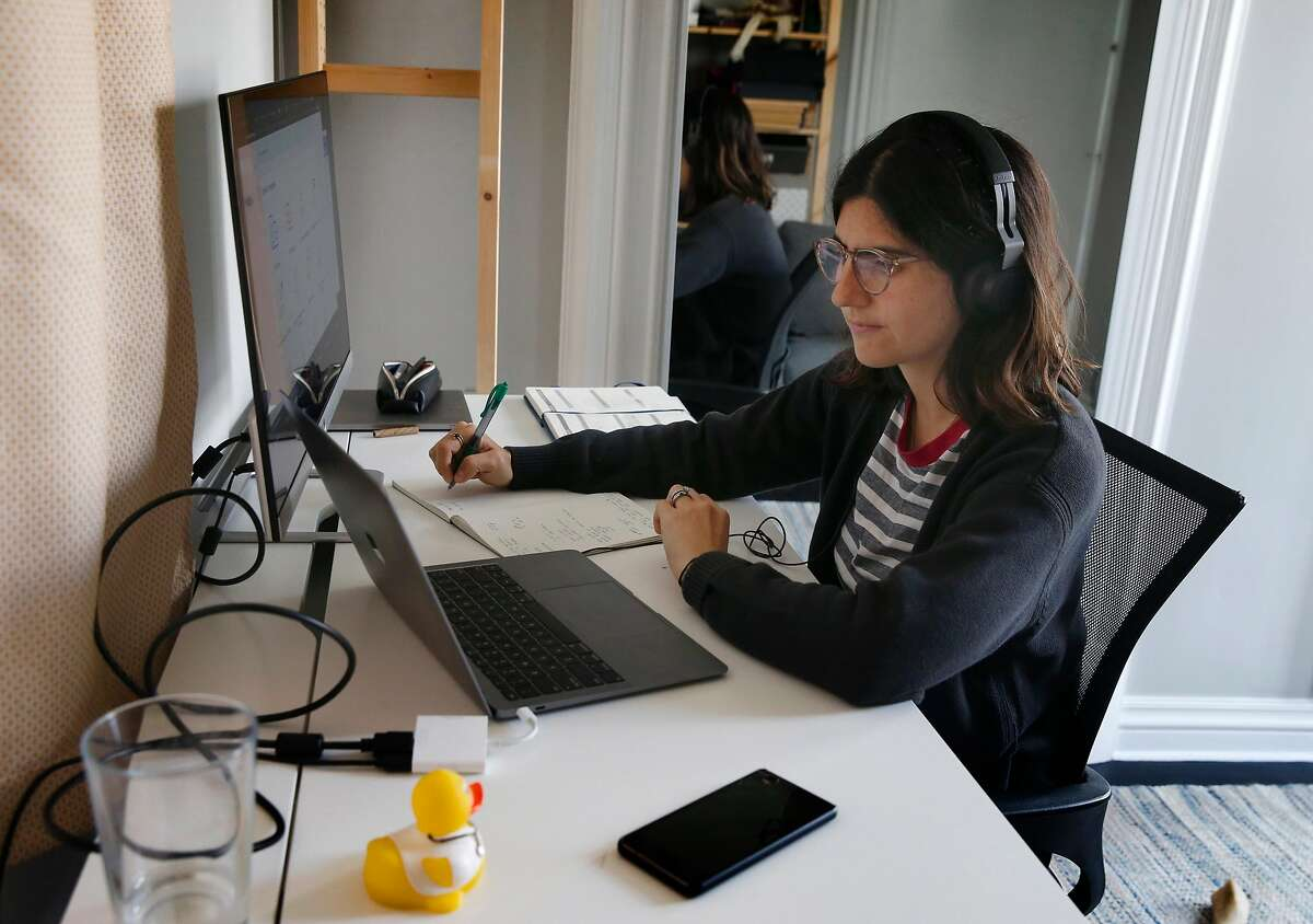 Dr. Lucia Abascal works a contact tracing shift for UCSF and speaks with COVID-19 patients from her home in San Francisco, Calif. on Thursday, June 25, 2020.