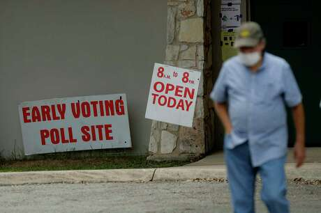 An early voter leaves a polling site, Tuesday, July 7, 2020, in San Antonio. Polling site workers are wearing masks and taking other precautions due to the COVID-19 outbreak. (AP Photo/Eric Gay)