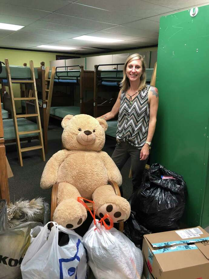 OBK Administrative Assistant Lila Ecker spends her time sorting through some of the donated items that will be at the annual yard sale. (Courtesy photo)