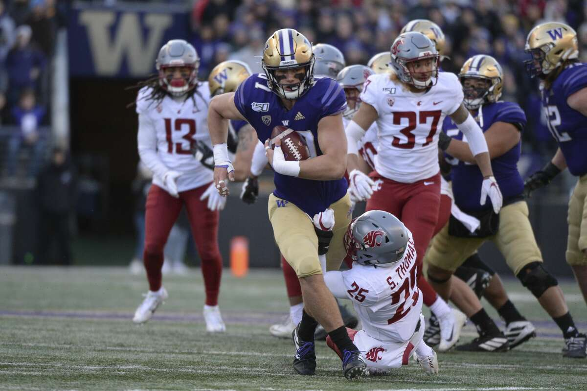 SEATTLE, WA - NOVEMBER 29: Washington Huskies tight end Cade Otton (87) is slowed down by Washington State Cougars safety Skyler Thomas (25) during a PAC12 football game between the Washington Huskies and Washington State Cougars on November 29, 2019, at Husky Stadium in Seattle, WA. (Photo by Jeff Halstead/Icon Sportswire via Getty Images)