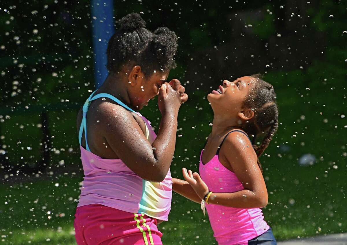 Sanyi Williams, 7, of Albany and her cousin Zy'aurea Cardona, 5, of Albany cool off at the Sheridan Park spray pad on Friday, July 17, 2020 in Albany, N.Y. (Lori Van Buren/Times Union)