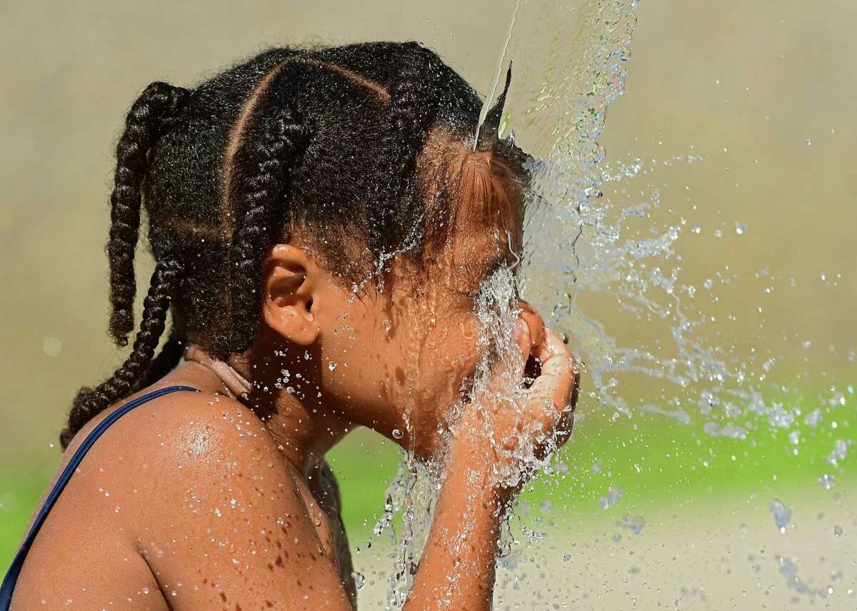 Zy'aurea Cardona, 5, of Albany cools off at the Sheridan Park spray pad on Friday, July 17, 2020 in Albany, N.Y. (Lori Van Buren/Times Union)