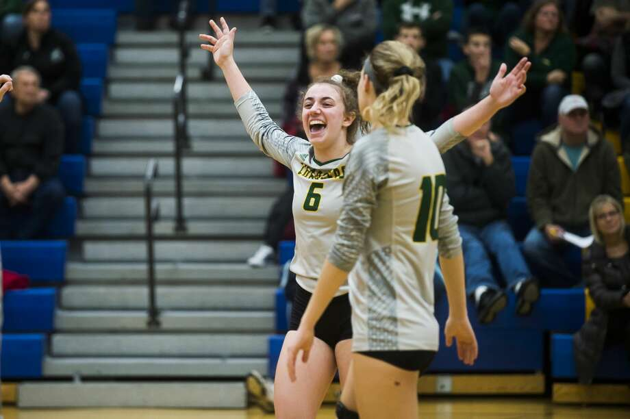 Dow High's Cheka Queary celebrates a point during a Nov. 6, 2019 district match vs. Midland High. Photo: Daily News File Photo