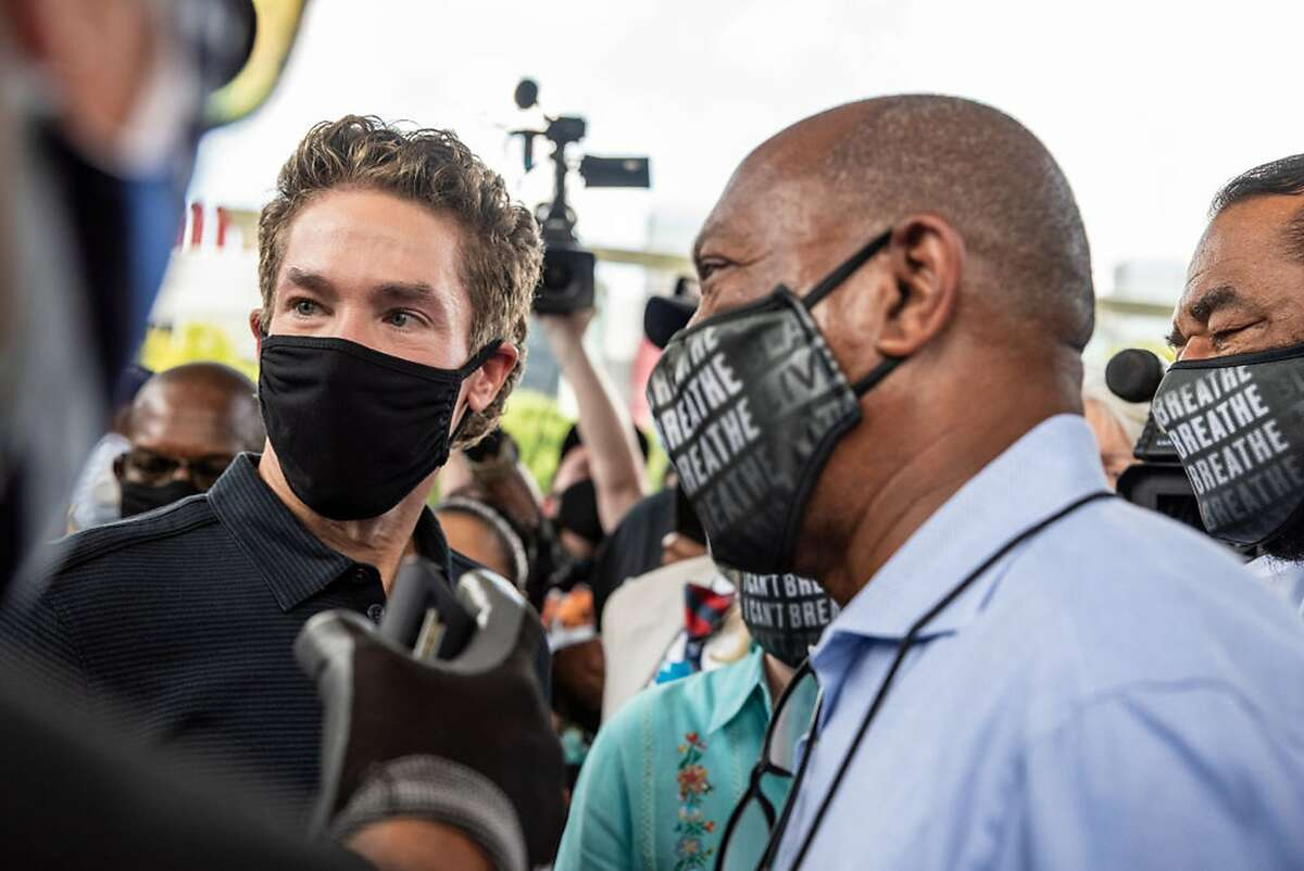 Pastor Joel Osteen and Houston Mayor Sylvester Turner talk at a march in honor of George Floyd on June 2, 2020 in Houston, Texas. (Photo by Sergio Flores/Getty Images/TNS)