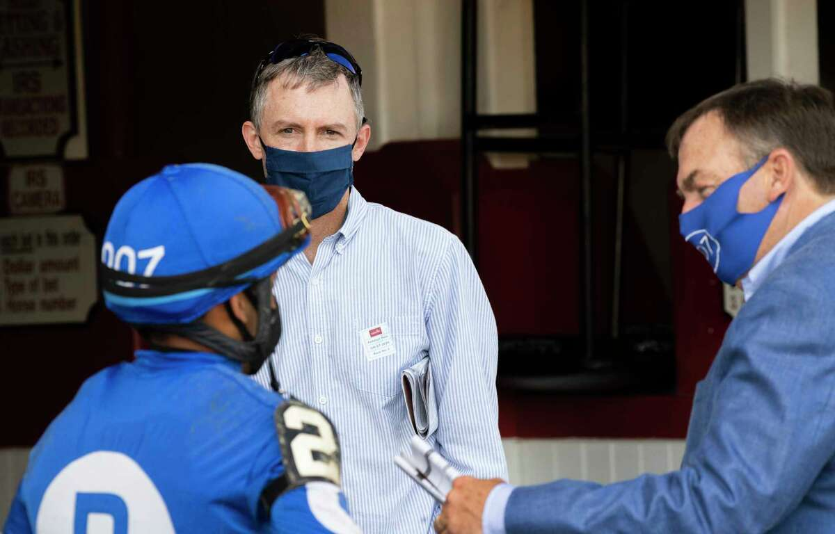 Boston Red Sox General Manager Brian O?• Halloran, center listens to trainer Jim Bond, right and jockey Manny Franco after Voliero competed unsuccessfully in the 5th race on the card at the Saratoga Race Course July 17, 2020 in Saratoga Springs, N.Y. Photo by Skip Dickstein/Special to the Times Union.