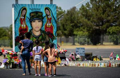 A family makes a stop to pay their respects to Army Spc. Vanessa Guillén on Friday, July 17, 2020. The memorial mural of Guillén is across from Fort Hood military post.