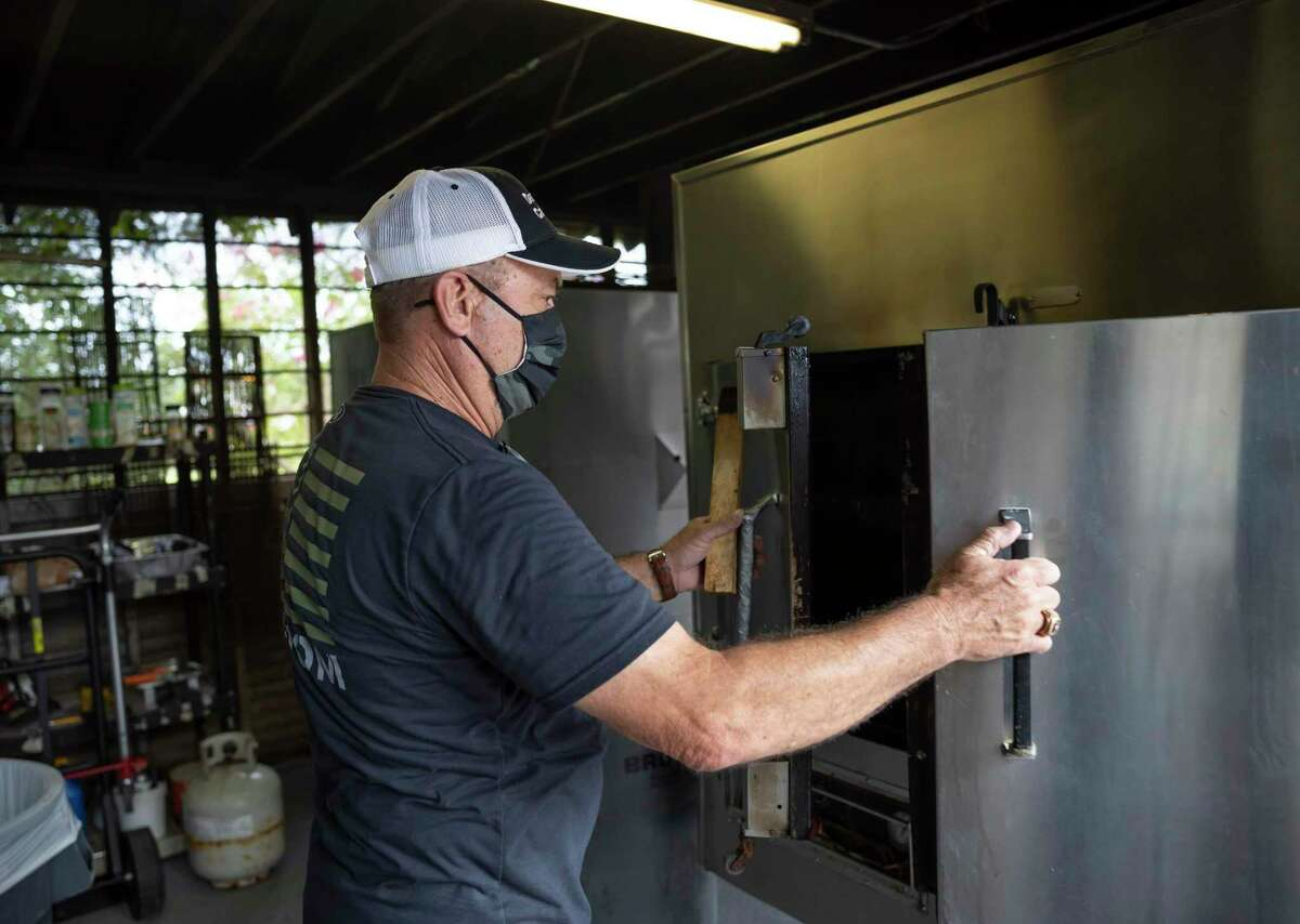 Mickey Childers, owner, opens an industrial smoker at Darrel's Catering in Conroe, Wednesday, July 15, 2020. Darrel's Catering has been operating for an estimated 30 years and this would be it's first time operating as a physical restaurant.
