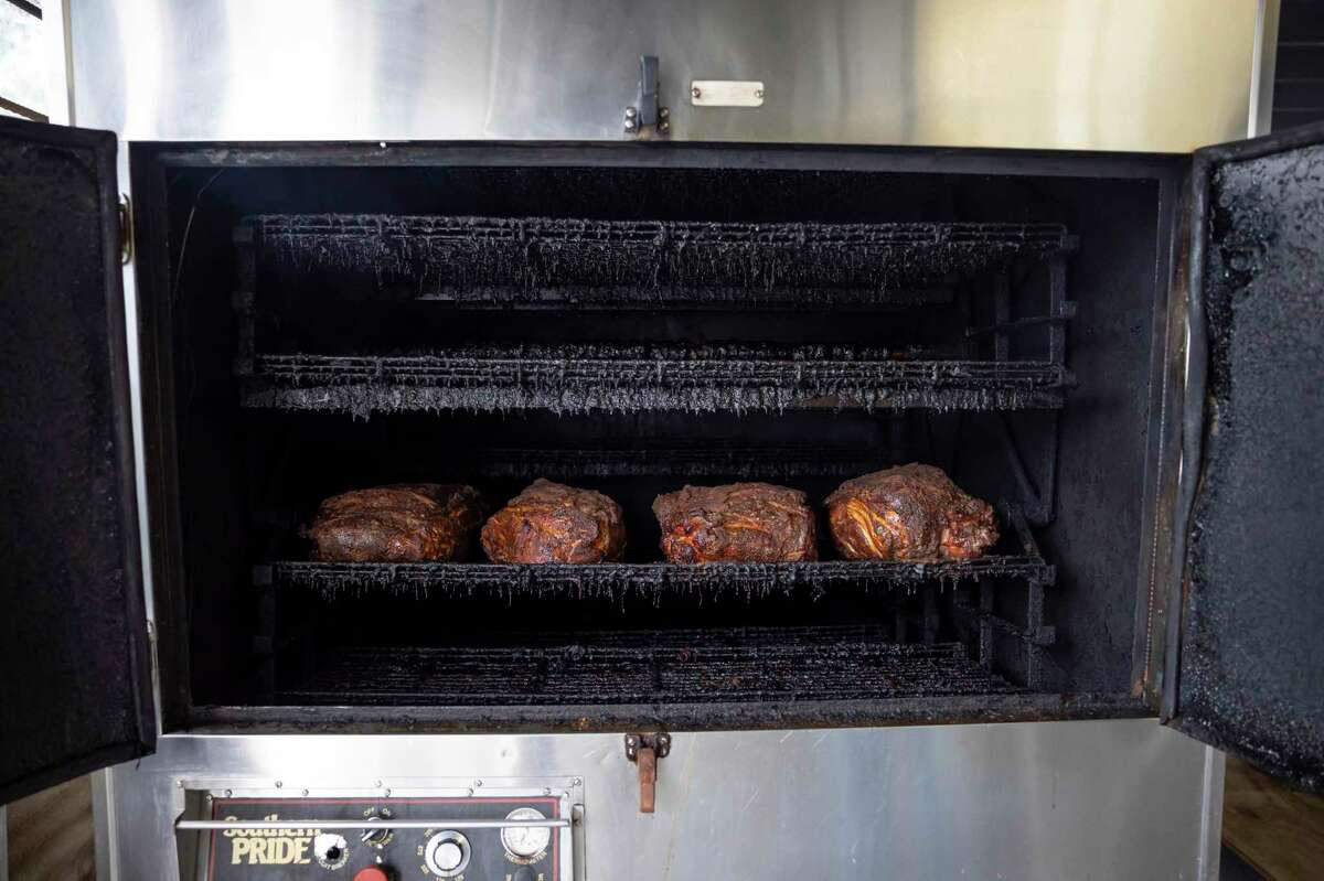 Pork rests in an industrial smoker as it cooks for up to 14 hours at Darrel's Catering in Conroe, Wednesday, July 15, 2020. Mickey Childers, owner, began planning to open a physical location in January 2019 but didn't break ground until the following November.