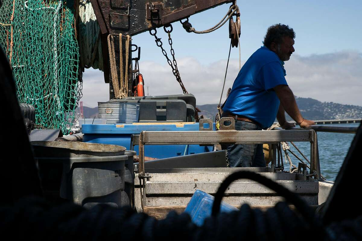 Giuseppe �Joe� Pennisi takes a moment at his Pioneer fishing boat outside Scoma�s Restaurant as he prepares for a move outside the San Francisco Bay, Friday, July 17, 2020, in San Francisco, Calif. Amid the coronavirus pandemic, the Pioneer will find a new harbor to sell fish.