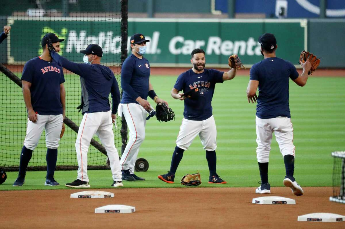 Houston Astros Abraham Toro, bench coach Joe Espada, Aledmys Diaz, Jose Altuve and Yuli Gurriel laugh together during the Astros summer camp at Minute Maid Park, Friday, July 17, 2020, in Houston.