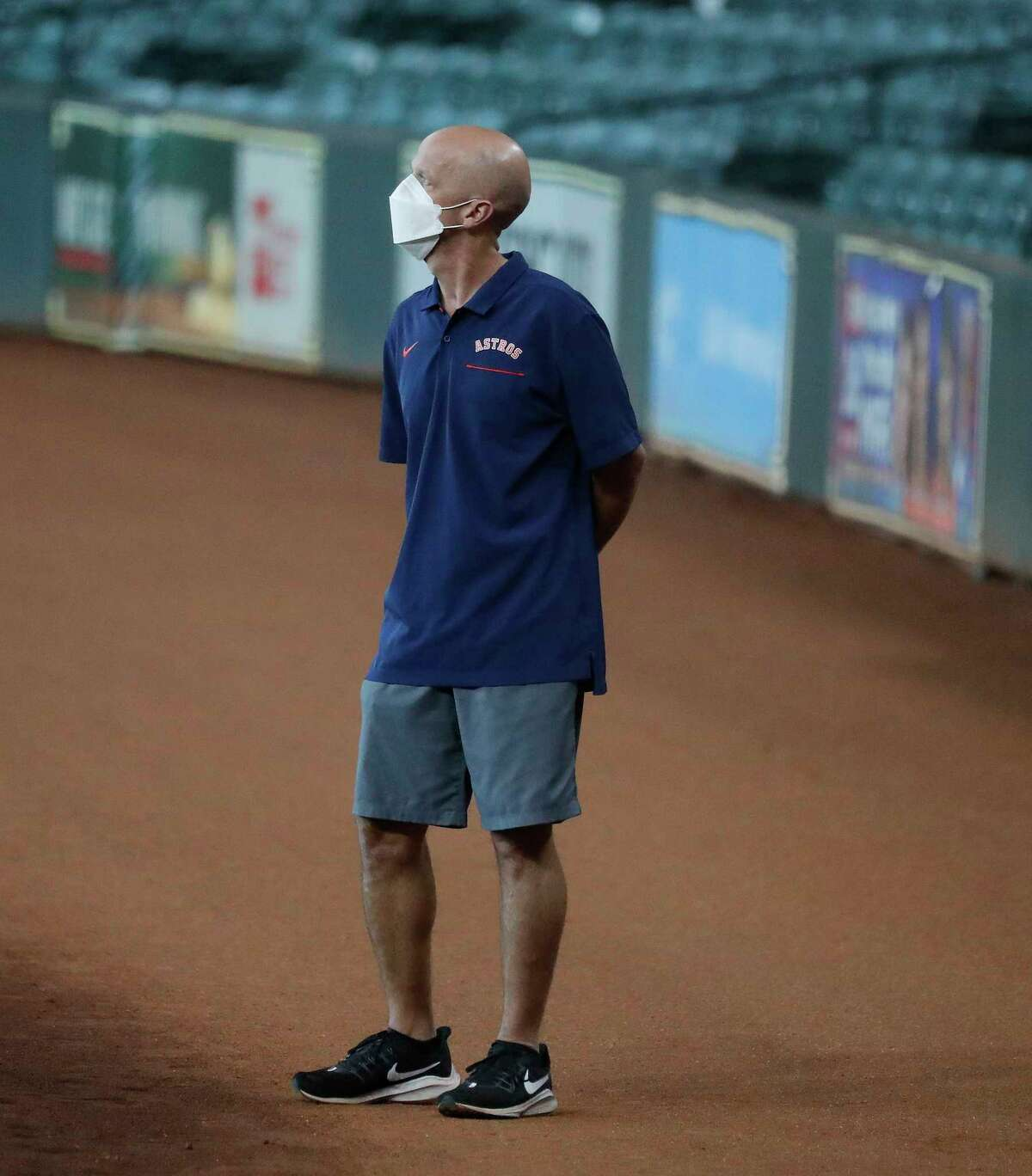 Houston Astros clubhouse manager Carl Schneider watches during the Astros summer camp at Minute Maid Park, Friday, July 17, 2020, in Houston.