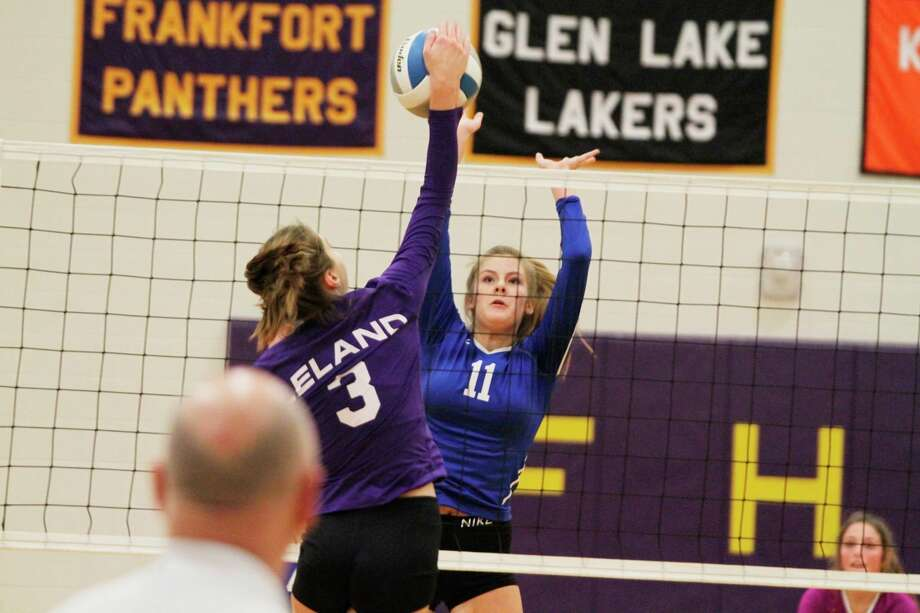 Onekama's Kaylin Sam goes up for a block during the Portagers' Division 4 district quarterfinal against Leland. (News Advocate file photo)