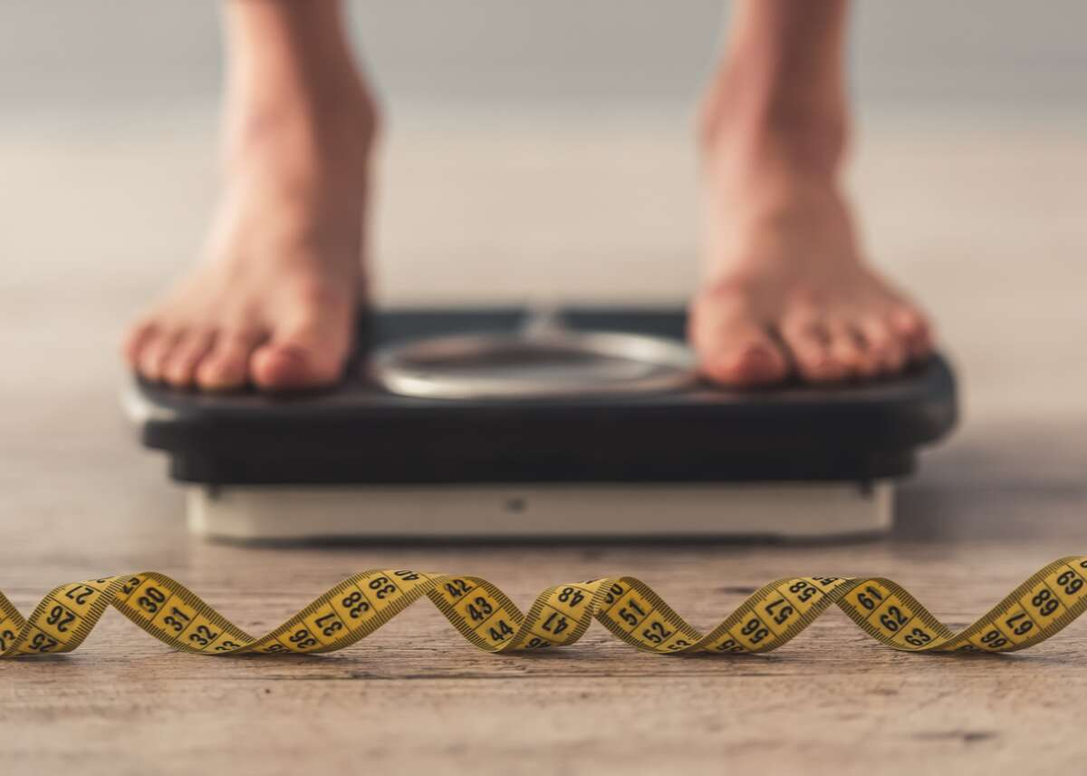 Overweight and obesity are defined by a person's body mass index, a ratio of an individual's weight and height. People with a BMI between 18.5 and 24.9 are considered to be of healthy weight; the overweight zone ranges from a BMI of 25 through 29, and obesity starts at a BMI of 30.