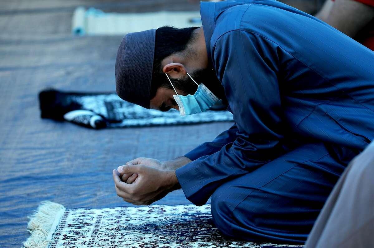 At Abdullah Anwar, nephew of Imam Tahir Anwar, prays as his uncle leads congregants in prayer at SBIA Mosque, Masjid al-Mustafa on Friday, July 17, 2020, in San Jose, Calif.