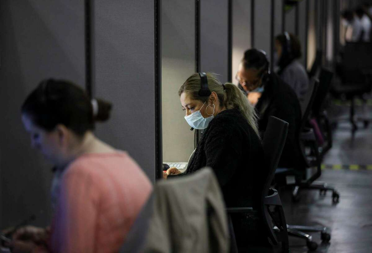 Mary Estevez-Hayes works in the Contact Monitoring and Contact Tracing Unit of the Houston Health Department on Friday, July 17, 2020, at the George R. Brown Convention Center in Houston.