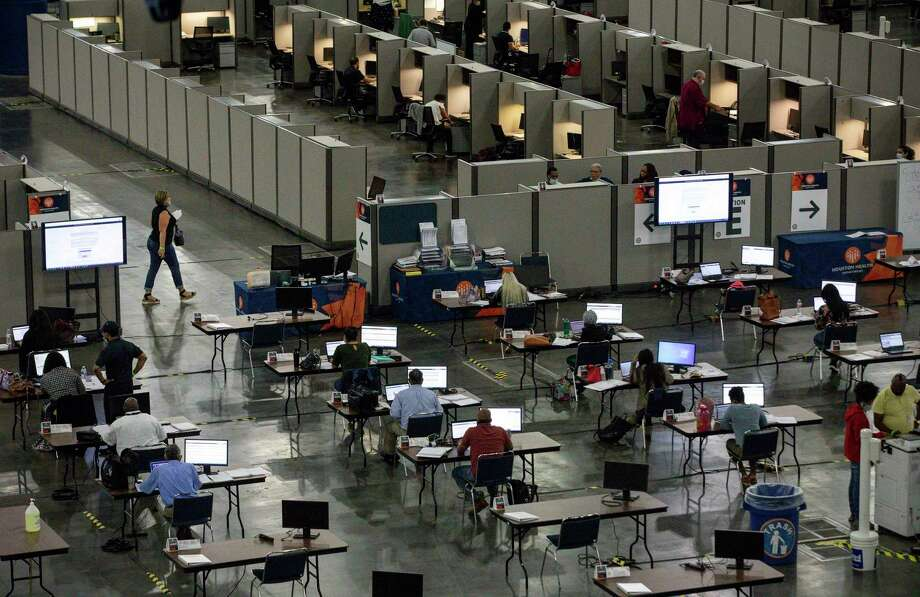 People work in the Contact Monitoring and Contact Tracing Unit of the Houston Health Department on Friday, July 17, 2020, at the George R. Brown Convention Center in Houston. Photo: Jon Shapley, Houston Chronicle / Staff Photographer / © 2020 Houston Chronicle