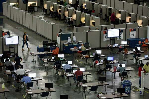 People work in the Contact Monitoring and Contact Tracing Unit of the Houston Health Department on Friday, July 17, 2020, at the George R. Brown Convention Center in Houston.