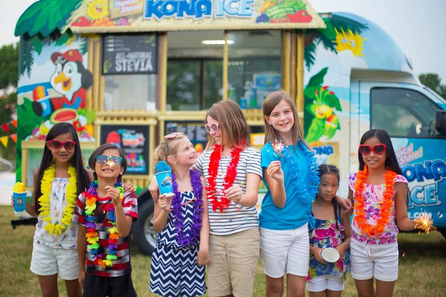 FILE — A group of Kona Ice customers celebrate a birthday party. Kona Ice of North Marin has adapted to delivery amid the pandemic. Often, their stops have been arranged by parents who want to surprise their children. Photo: Kathryn Huyge/ Kona Ice