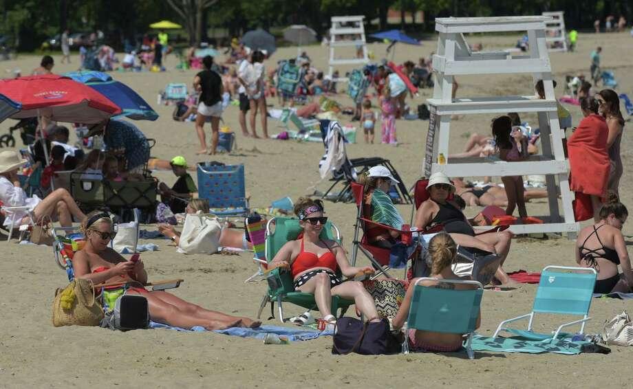 File photo of beachgoers at Calf Pasture Beach Thursday, July 16 2020, in Norwalk, Conn. Photo: Erik Trautmann / Hearst Connecticut Media / Norwalk Hour