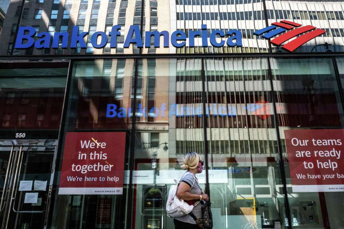 A pedestrian wearing a protective mask walks past a Bank of America Corp. branch in New York, U.S., on Sunday, July 12, 2020. The bank added $3.6 billion to its loan-loss reserve in the second quarter. Photographer: Jeenah Moon/Bloomberg
