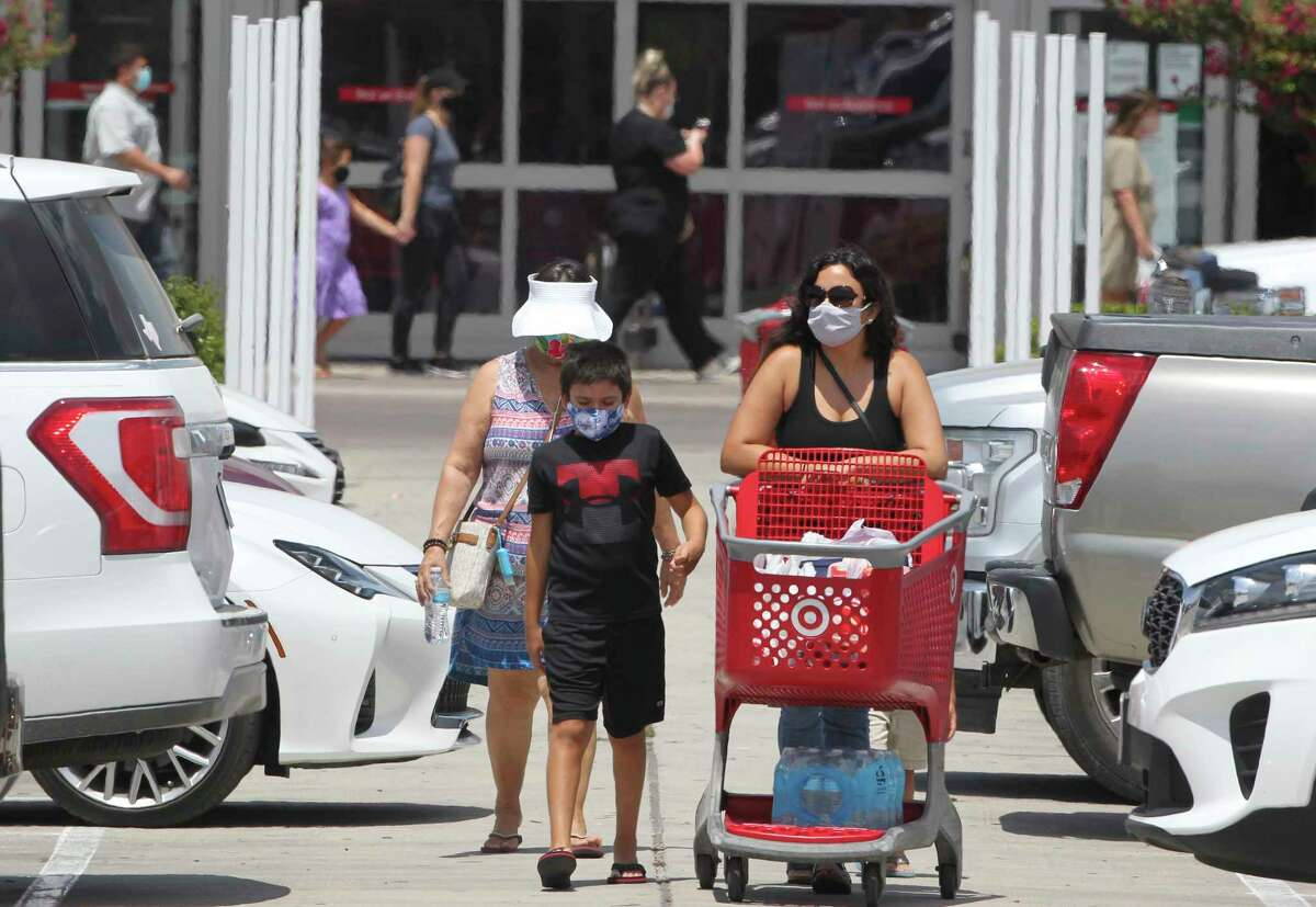 Shoppers flow in and out of the Target store at Creekside in New Braunfels public places on July 17, 2020. Most were wearing face coverings. The total for Covid-19 cases in Comal County was increased by 90 to a 1558.