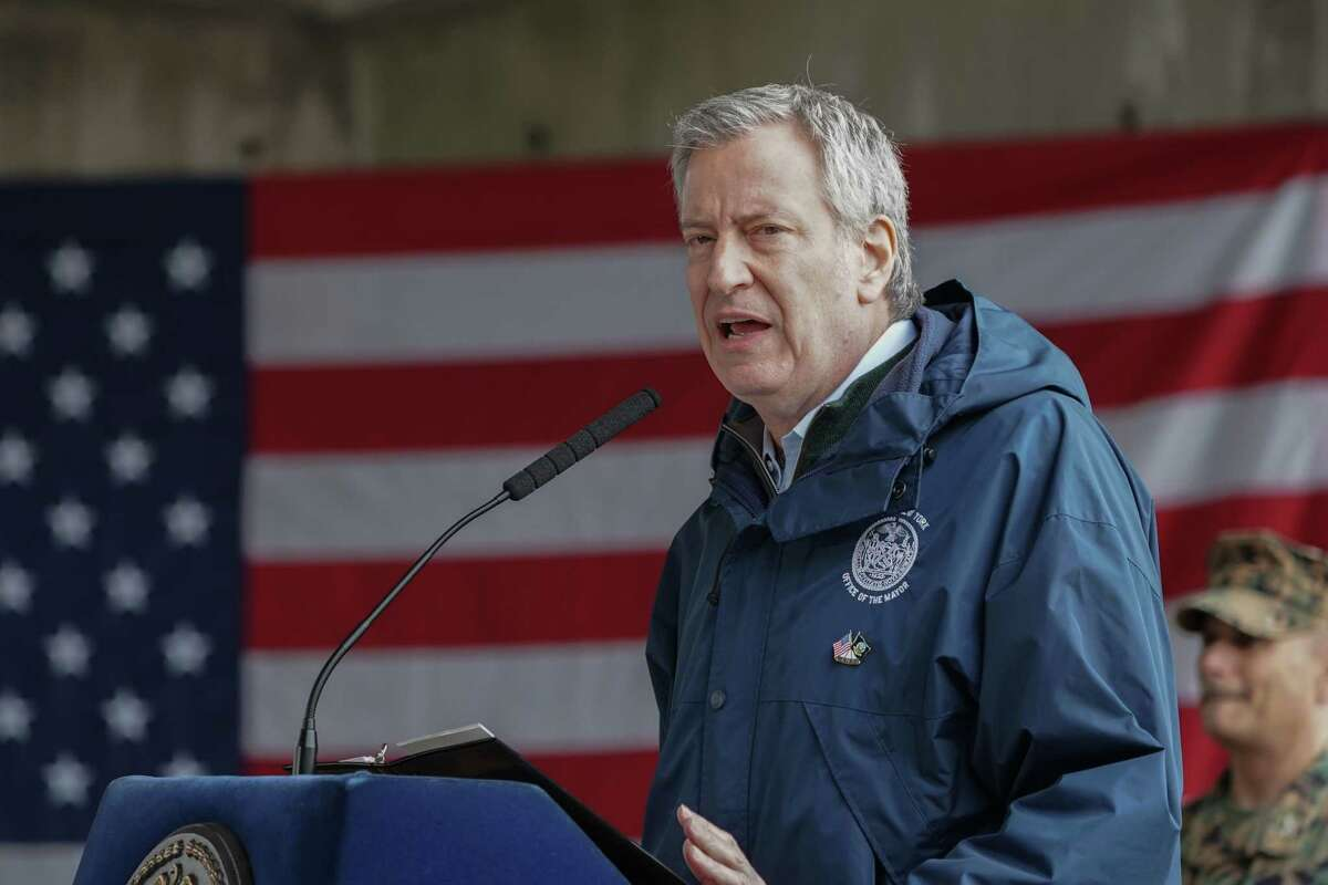(FILES) In this file photo New York Mayor Bill de Blasio speaks at Pier 90 on March 30, 2020 in New York. - New York Mayor Bill de Blasio early June 7, 2020 lifted a curfew he had imposed on the city for nearly a week as anti-racism protests raged there and nationwide.