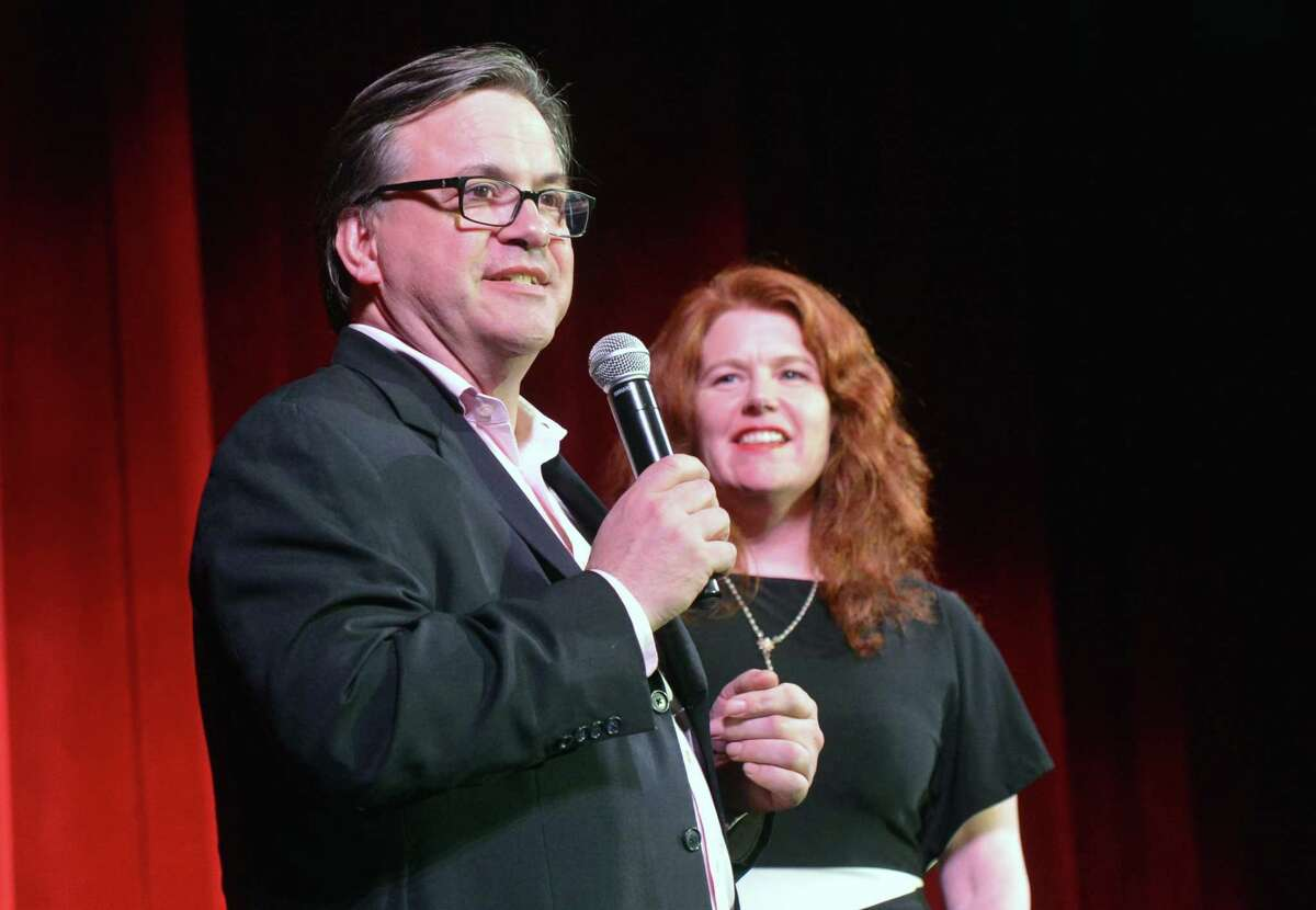 Frank Farricker and Suzanne Cahill, the developer and president of The Wall Street Theater take to the stage during a performance on Monday May 15, 2017 in Norwalk Conn.