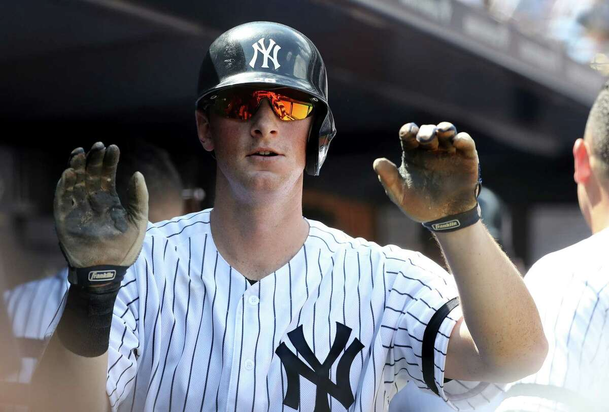 NEW YORK, NEW YORK - AUGUST 03: DJ LeMahieu #26 of the New York Yankees celebrates his two run home run in the fourth inning against the Boston Red Sox during game one of a double header at Yankee Stadium on August 03, 2019 in the Bronx borough of New York City. (Photo by Elsa/Getty Images)