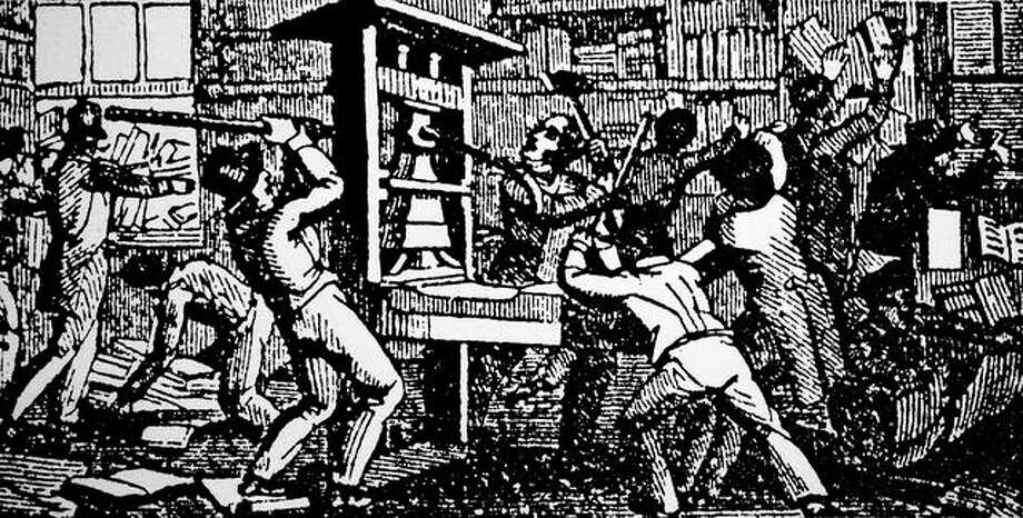 A woodcut engraving depicts the destruction of the abolitionist printing press of the Alton Observer on July, 20, 1837. The press was attacked and the editor Elijah Parish Lovejoy was shot by a drunken mob. Photo: Universal History Archive | Universal Images Group (via Getty Images)
