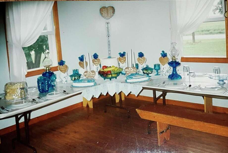 Tables decorated for Lovina and Joe Eicher's wedding in 1993. (Courtesy photo)